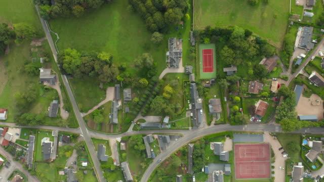 förortsområde liten stad i europa, breda aerial birds eye upprättande shot, sommar - fransk kultur bildbanksvideor och videomaterial från bakom kulisserna