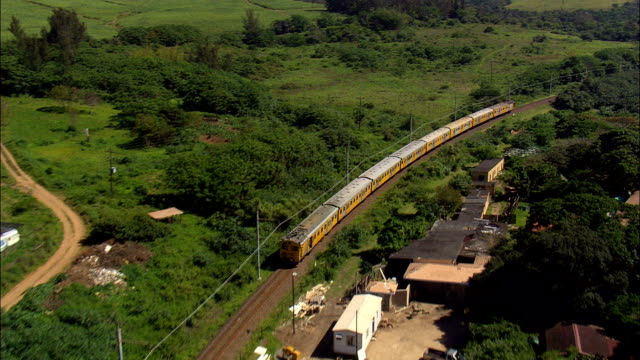 Suburban Train Out Of Kelso  - Aerial View - KwaZulu-Natal,  South Africa This clip was filmed by Skyworks on HDCAM SR 4:4:4 using the Cineflex gimbal. KwaZulu-Natal,   South Africa natal stock videos & royalty-free footage