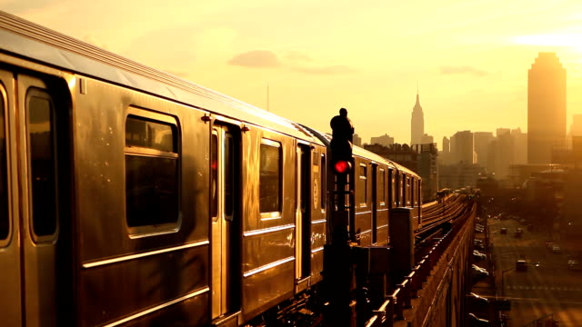 subway 7 train at sunset in queens new york city - train stock videos and b-roll footage