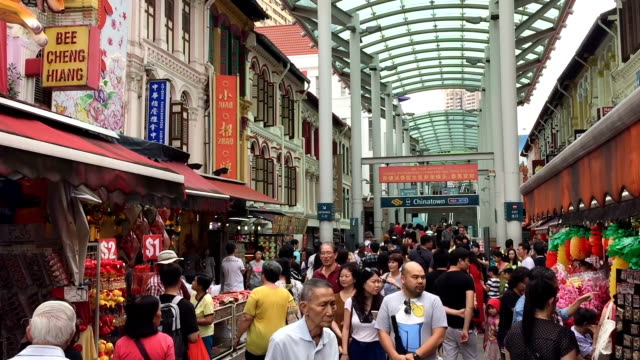 Subway entrance and Chinatown market in Singapore