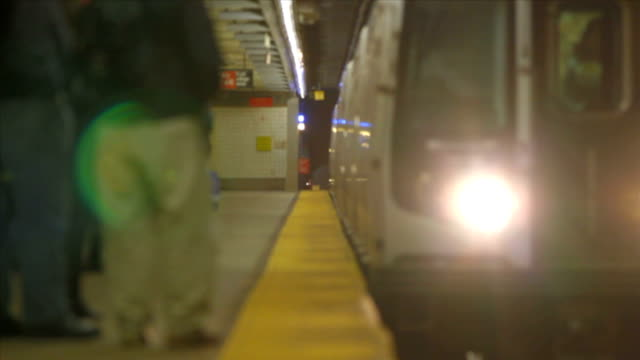 NYC Subway Passengers Boarding Tilt Shift v3. NYC subway train arriving at platform and then people boarding and disembarking. subway station stock videos & royalty-free footage