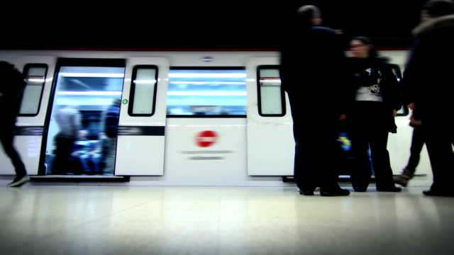 Subway station. Time lapse. Locked. Loopable. Subway train arriving. Time lapse. Visible logos and faces were blurred. Full HD. Video created exclusively for iStockphoto.  subway platform stock videos & royalty-free footage