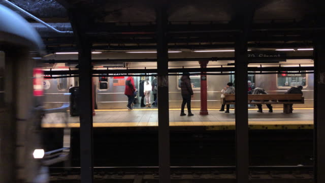 Subway Train Arrives A subway train arrives into a station on the 72nd St platform in New York City. This slow motion clip is located in the Upper West Side of Manhattan. new york city subway stock videos & royalty-free footage