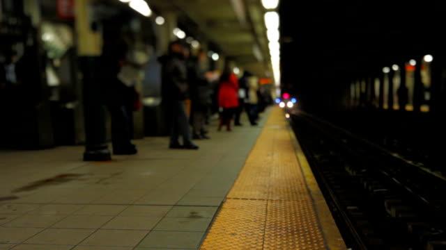 NYC Subway Train Arriving Tilt Shift v2. NYC subway train arriving to platform. subway platform stock videos & royalty-free footage