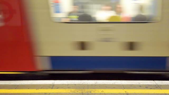 Subway train leaving the platform.
