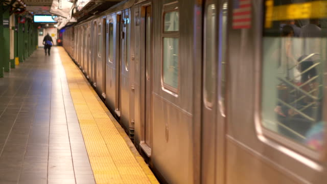 NYC Subway Train leaving the station in 4K Slow motion 60fps video