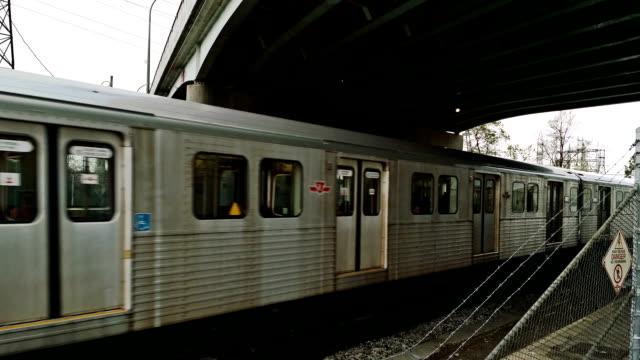 subway train pass under bridge with danger sign. - billboard train station bildbanksvideor och videomaterial från bakom kulisserna