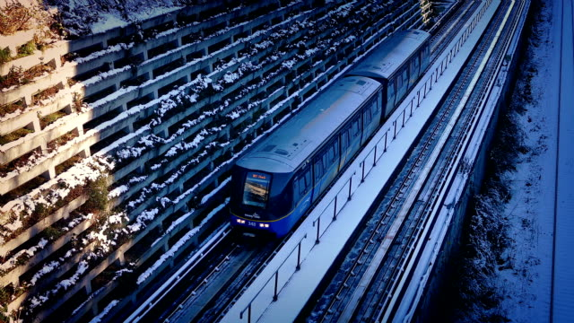 Subway Train Passes In The Snow Subway train passing on snowy tracks in winter vancouver canada stock videos & royalty-free footage