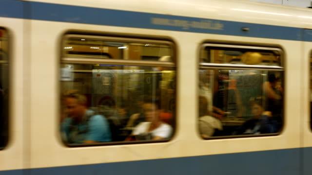 subway trains departing the station (4k/uhd to hd) - munich train station bildbanksvideor och videomaterial från bakom kulisserna