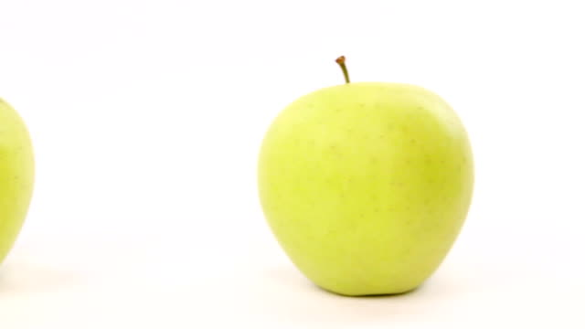 success chooses red apple from line with green apples video