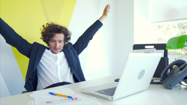 Success is always on his side. Businessman being happy when he found out that the project was a real success and everything was perfect. salesman stock videos & royalty-free footage
