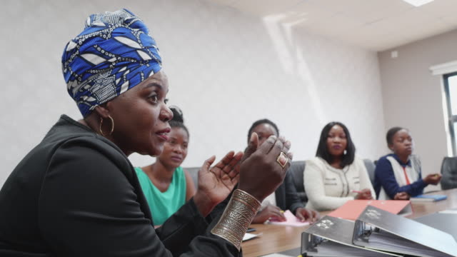 Successful African Businesswoman Chairing a Staff Meeting