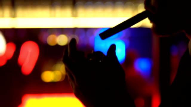framgångsrik ungkarl i kostym belysning cigarr, spendera fritid i strippklubb - spendera pengar bildbanksvideor och videomaterial från bakom kulisserna