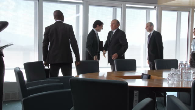 HD: Successful Business Negotiations HD1080p: Group of business men and women shaking hands after successful negotiations in the conference room. formalwear stock videos & royalty-free footage