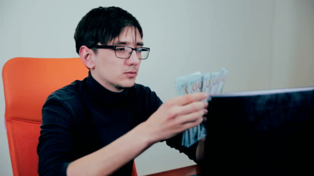 Successful businessman counting money, happy about his earnings, income video