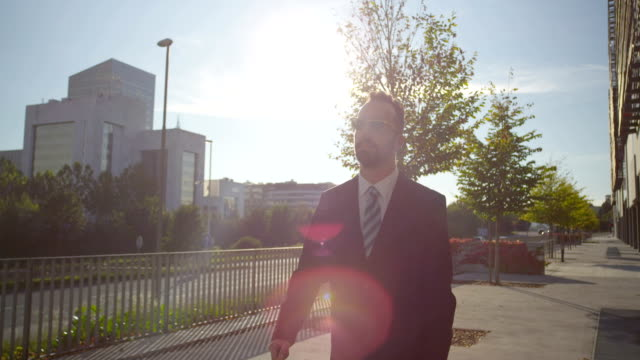 SLOW MOTION: Successful businessman walking along the business district video