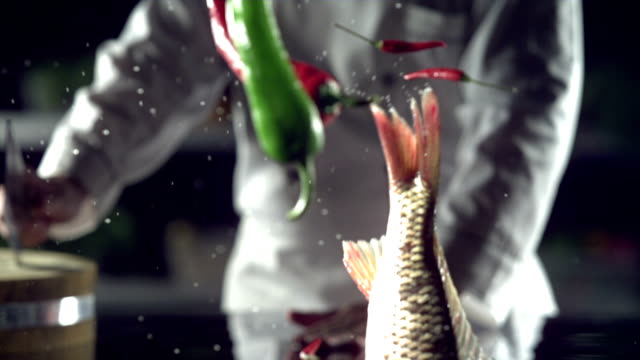 Successful chef,cooking,Flying fish,slow motion video