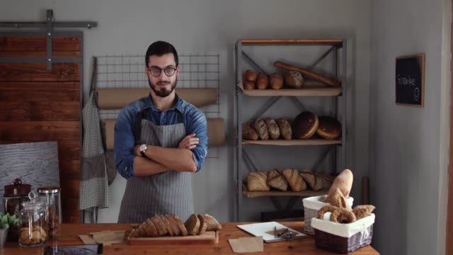 successful entrepreneur in his bakery - small business owner stock videos & royalty-free footage