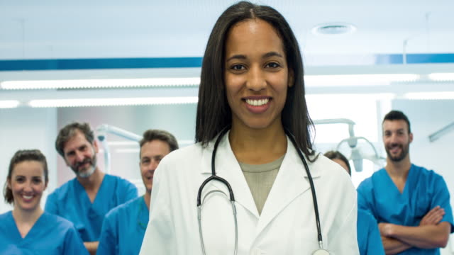 Successful female doctor with her staff video