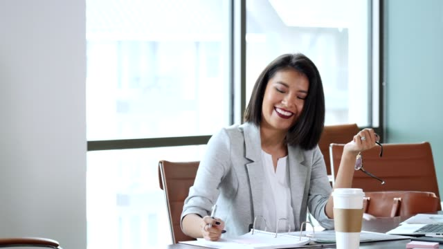 Successful female lawyer works on a document