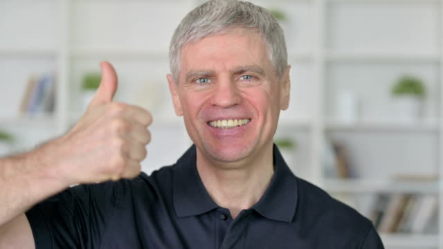 successful middle aged businessman showing thumbs up - one mature man only stock videos & royalty-free footage