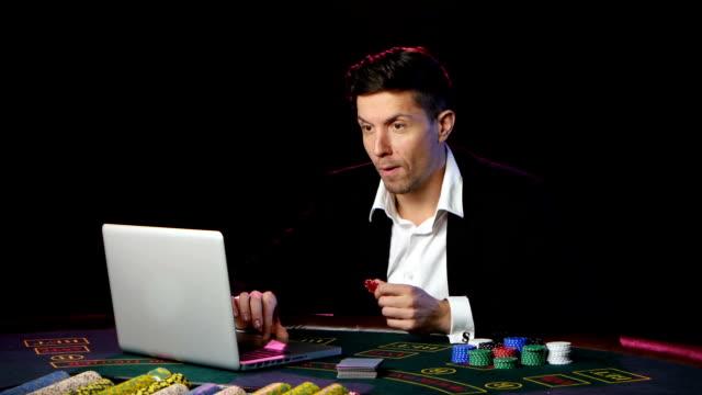 Successful online casino player winning. Close up video