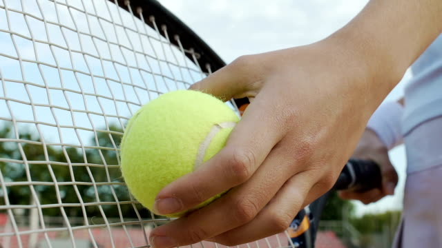 Successful self-confident woman serves tennis ball, desire to win, bottom view video