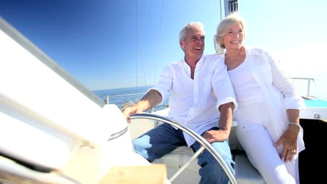 successful seniors aboard their yacht - affluent lifestyles stock videos & royalty-free footage