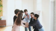istock Successful united business team stacking hands together express teamwork 1204018829