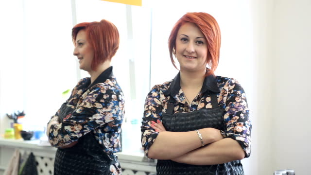 Successful woman in the hairdresser's business. - video