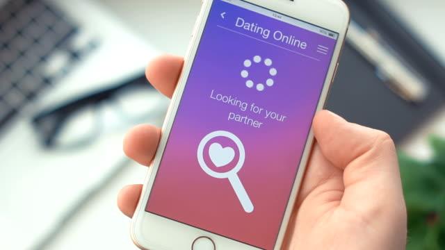 vídeos de stock e filmes b-roll de successfully searching for partner on dating app on the smartphone - namorar