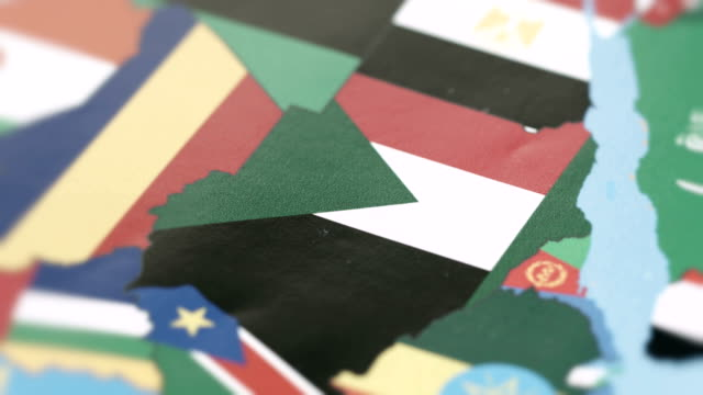 sudan borders with national flag on world map - sudan del sud video stock e b–roll