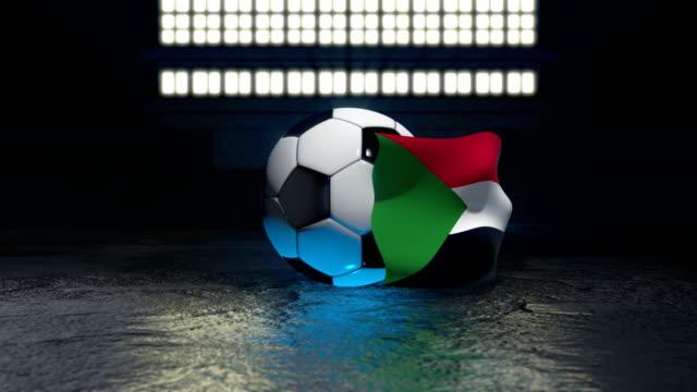 sudan flag flies around a soccer ball - insygnia filmów i materiałów b-roll