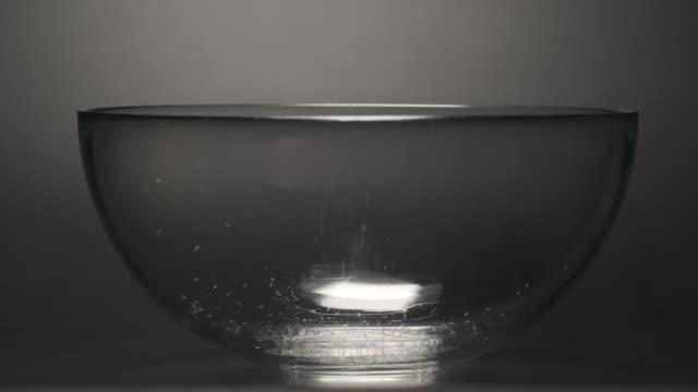 SLOW MOTION: Sugar falls into a mixing bowl video