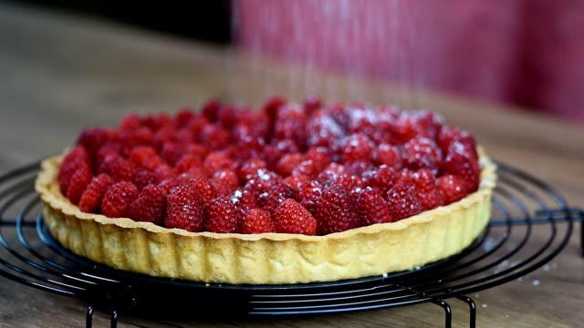 sugar falls on raspberry tart video