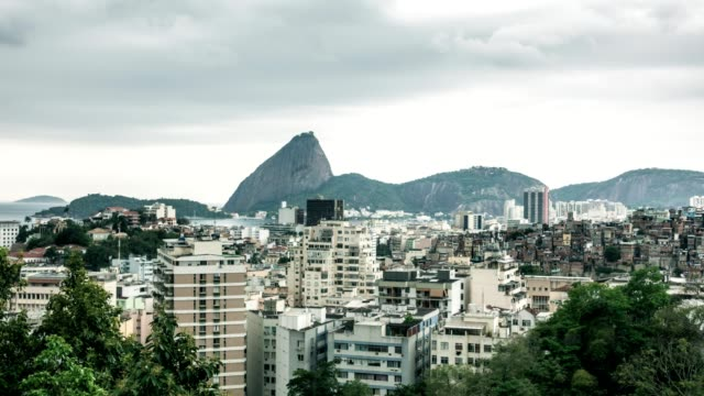 Sugarloaf from Santa Teresa, in Rio de Janeiro, with cityscape view in storm sky timelapse