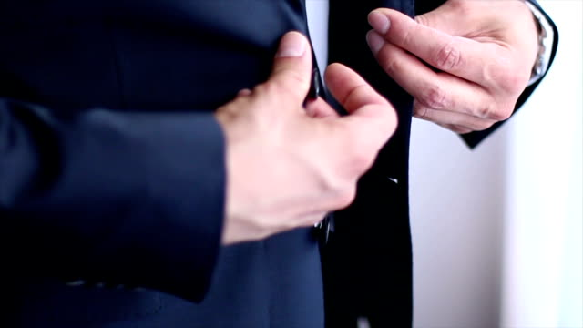 stockvideo's en b-roll-footage met pak en handen - men blazer