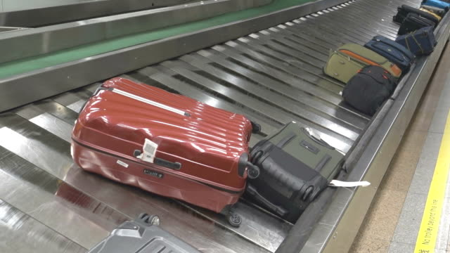 suitcases on a luggage band on the airport video