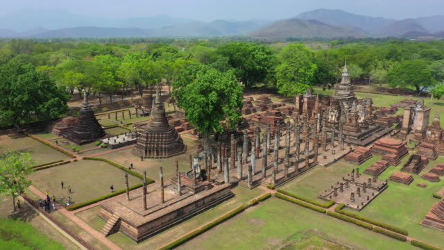 Sukhothai Historical Park in Sukhothai province, Thailand. Aerial view from flying drone Sukhothai Historical Park in Sukhothai province, Thailand. Aerial view from flying drone sukhothai stock videos & royalty-free footage