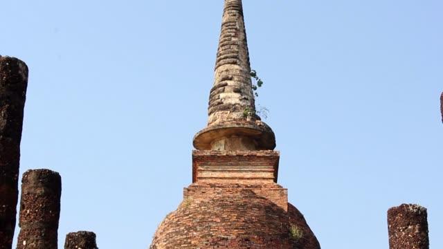 Sukhothai tilt-down Ancient buddha statue. Sukhothai Historical Park, Sukhothai Province, Thailand sukhothai stock videos & royalty-free footage