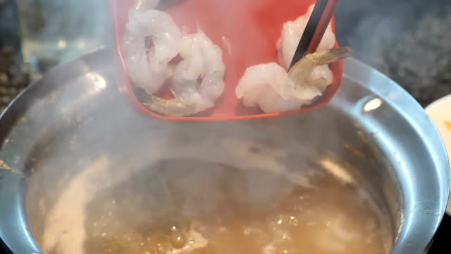 Suki or Shabu boiling in electric pot with turnips, morning glory, pork chops, squid, corn, vermicelli and pork. video Slow motion Suki or Shabu boiling in electric pot with turnips, morning glory, pork chops, squid, corn, vermicelli and pork. video Slow motion generation x stock videos & royalty-free footage