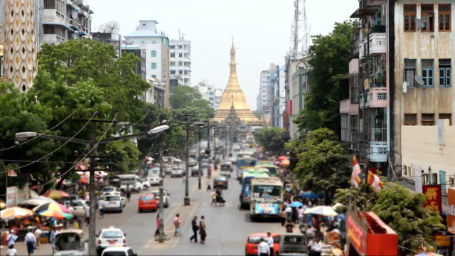 Sule Pagoda Road of traffic:Time lapse Time lapse:View from a pedestrian overpass on Sule Pagoda Road of traffic, people, and buildings in downtown Yangon. The historic Sule Pagoda is at the end of the street;High Definition 1920x1080 Format myanmar stock videos & royalty-free footage