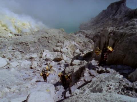 Sulfur miners atop Mount Ijen volcano Indonesia video