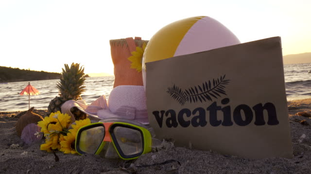 Summer accessories with ''Vacation'' Tag  on Cardboard