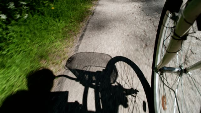 summer bike ride. shadow silhouette - pantaloni capri video stock e b–roll