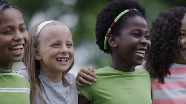 Summer camp kids outside together Happy elementary age children of multiple ethnic backgrounds outside together playing at summer camp. elementary age stock videos & royalty-free footage