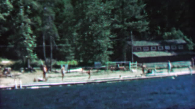 1967: Summer camp outdoor lake boating fun wilderness beach. video