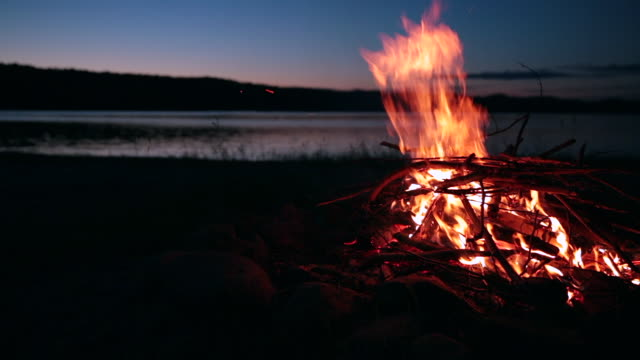 summer campfire and lake at sunset - lakeshore stock videos & royalty-free footage