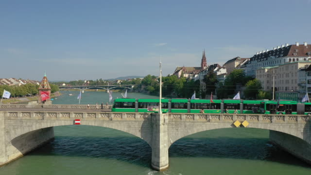 summer day flight over basel city river traffic bridge aerial panorama 4k switzerland - vídeo