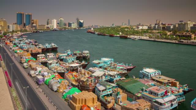 summer dubai city deira creek cargo ship parking 4k tim elapse united arab emirates - 7 star stock videos and b-roll footage